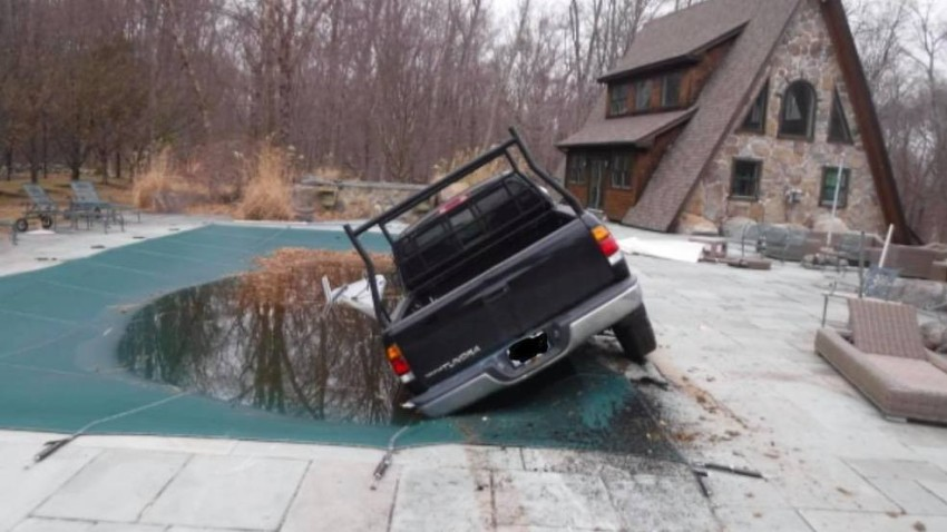 An alleged drunken driver was arrested on Monday, Jan. 13, 2020 after his truck was discovered partially submerged in a swimming pool in Scituate, Rhode Island.