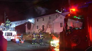 A fire at a multi-family home displaced 16 people overnight Friday, Dec. 27, 2019 in Hull, Massachusetts.