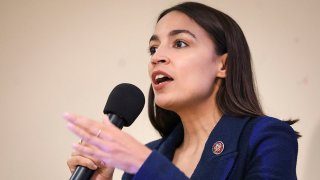 In this Oct. 3, 2019, file photo, U.S. Rep. Alexandria Ocasio-Cortez (D-NY) speaks during a town hall meeting at the LeFrak City Queens Library in the Queens borough of New York City.
