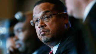 In this Dec. 2, 2016, file photo, U.S. Rep. Keith Ellison, D-Minn., listens as Ray Buckley, chair of the party in New Hampshire, speaks during a forum on the future of the Democratic Party in Denver, Colorado. The candidates spoke during the Association of State Democratic Chairs session.