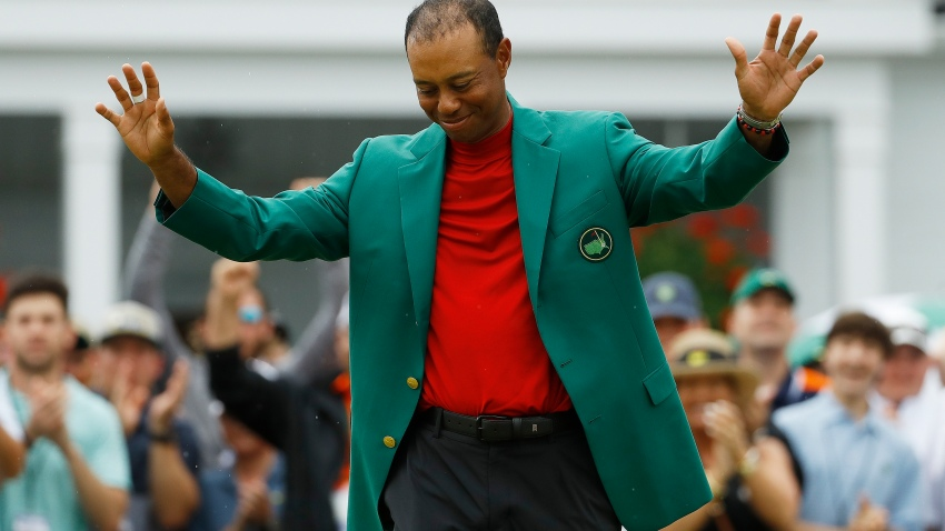 Tiger Woods smiles as he wears his green jacket after winning the Masters golf tournament in Augusta, Ga. Fourteen years after his last Masters win and 11 years after his last major, after fighting through chronic back problems, multiple surgeries, a bout with painkillers and long after just about everybody had written him off, Woods claimed his fifth green jacket.