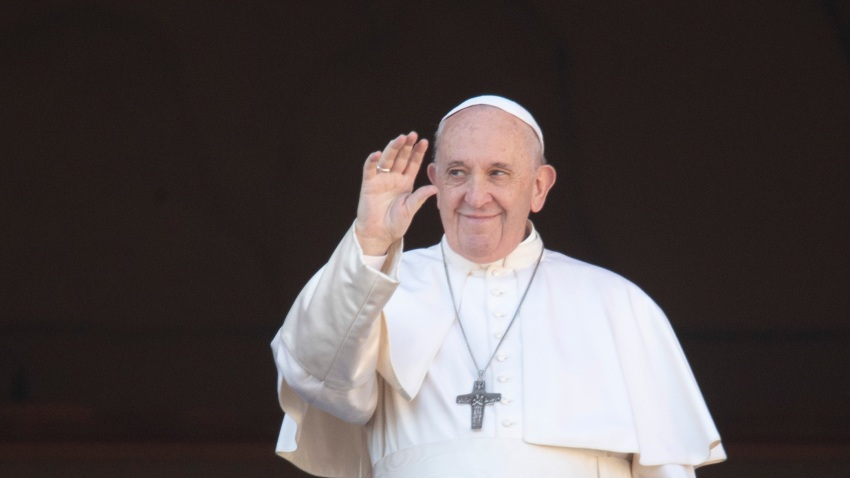 "In this Dec. 25, 2019, file photo, Pope Francis waves to the faithful as he arrives to deliver the Urbi et Orbi (Latin for ""to the city and to the world"") Christmas day blessing from the main balcony of St. Peter's Basilica at the Vatican."