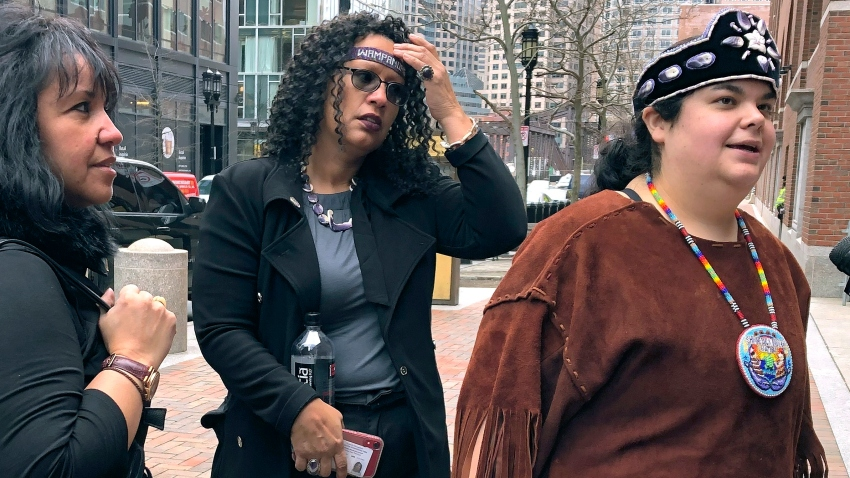 Tela Troge, right, a lawyer for the Shinnecock Indian Nation from Southampton, N.Y., speaks outside federal court Wednesday, Feb. 5, 2020, in Boston. She was in court with others, left, who came to support the Mashpee Wampanoag tribe at a hearing over land rights.