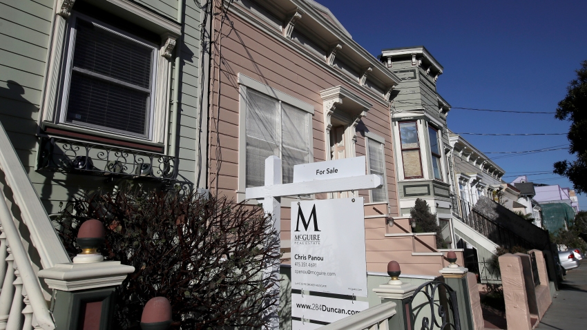 This Feb. 18, 2020, photo shows a real estate sign in front of a home for sale in San Francisco. On Thursday, Feb. 27, Freddie Mac reports on this week's average U.S. mortgage rates.