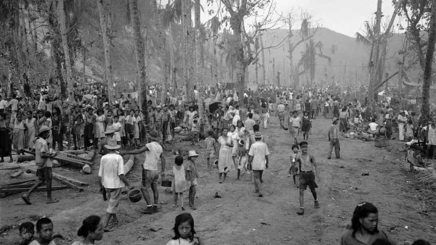 islanders enter a refugee camp in Guam during World War II