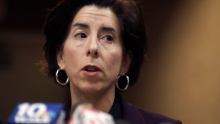 Rhode Island Gov. Gina Raimondo faces reporters during a news conference, March 1, 2020, in Providence, Rhode Island.