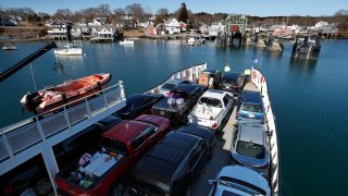 An automobile ferry arrives at North Haven, Maine, March 16, 2020. The North Haven Select Board voted to ban visitors and seasonal residents immediately to prevent the spread of the coronavirus to the island in Penobscot Bay.