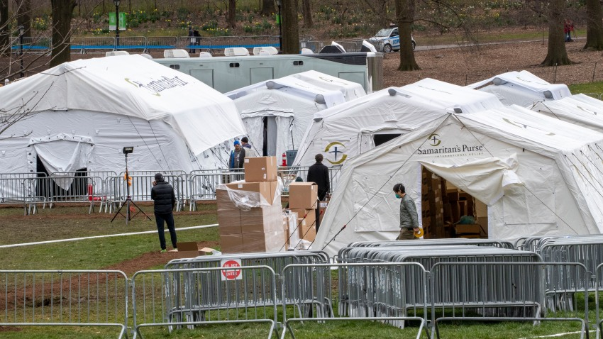 In this March 31, 2020, file photo, Samaritan's Purse crew and medical personnel work on preparing to open a 68 bed emergency field hospital specially equipped with a respiratory unit in New York's Central Park in New York.