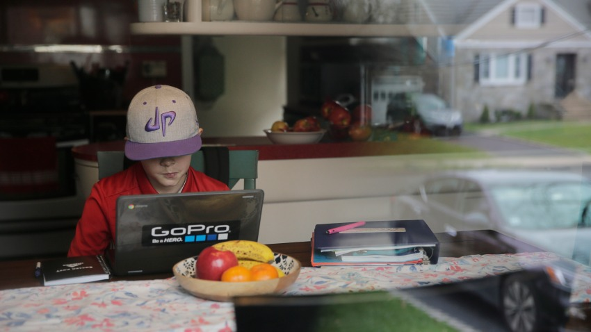 Colin Powers, 9, streams a math lesson broadcast by public television on a laptop at his home in Union, N.J.