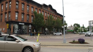 A car passes through downtown Winooski, Vermont, Tuesday June 9, 2020. Members of Winooski's immigrant community say that their members have been hit hard by the virus that causes COVID-19. The Vermont Health Department is working to contain the outbreak.