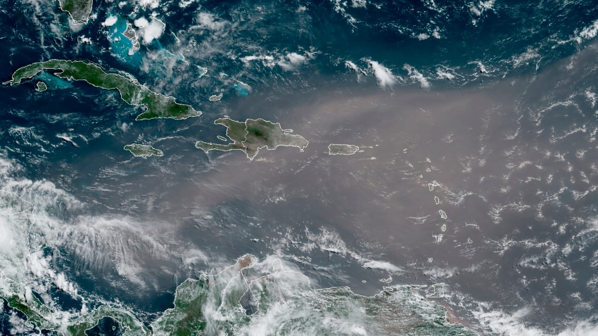 This satellite photo provided by the National Oceanic and Atmospheric Administration, NOAA, shows a cloud of dust coming from the Sahara desert arriving to the Caribbean Monday, June 22, 2020. The massive cloud of dust is blanketing the Caribbean as it heads to the U.S. with a size and concentration level that meteorologists say hasn't been seen in roughly half a century.