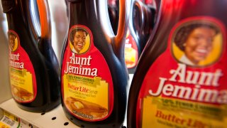 In this Aug. 3, 2011, file photo, bottles of PepsiCo Inc. Aunt Jemima syrup are displayed for sale at a ShopRite Holdings Ltd. grocery store in Stratford, Connecticut.