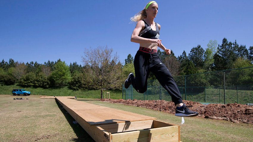 Olympic pole vaulting silver medalist Sandi Morris runs on the vaulting pit she is building with her father in Greenville, S.C., April 14, 2020.