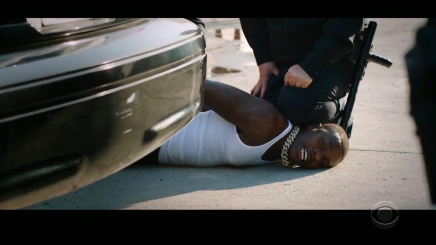 "In this video grab issued Sunday, June 28, 2020, by BET, rapper DaBaby performs ""Rockstar"" as an actor playing a police officer presses his knee on DaBaby's neck, replicating the last few moments of George Floyd's life, during the BET Awards."