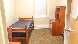 Standard college/university/boarding student dormitory room.