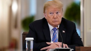In this June 26, 2020, file photo, President Donald Trump participates in a meeting of the American Workforce Policy Advisory Board in the EastRoom of the White House in Washington, D.C.