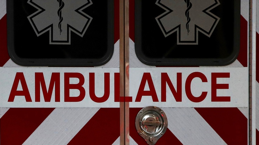 the back doors of an ambulance with the word ambulance emblazoned across the double doors