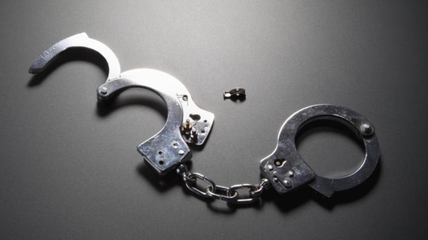 Generic_Handcuffs_Chris_Caesar_NECN_12416