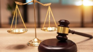 Justice Scales and books and wooden gavel