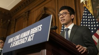 In this Sept. 19, 2019, file photo, Nathan Law, founding chairman and standing committee member of the Demosisto political party, speaks during a news conference about the Hong Kong Human Rights and Democracy Act on Capitol Hill in Washington, D.C..jpg