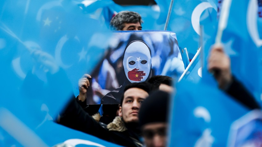Demonstrators take part in a demonstration in support of Uyghur Turks against human rights violations of China, in Berlin, Germany on December 27, 2019.
