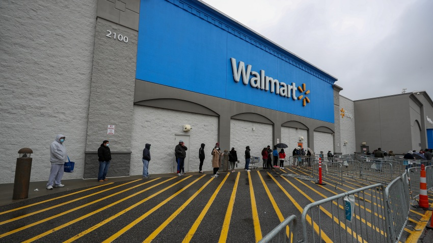 People line up outside a Walmart in New Jersey on April 18, 2020.
