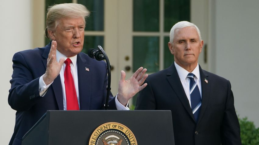 President Donald Trump speaks as Vice President Mike Pence look on during a news conference on the novel coronavirus, COVID-19, in the Rose Garden of the White House in Washington, DC on April 27, 2020.