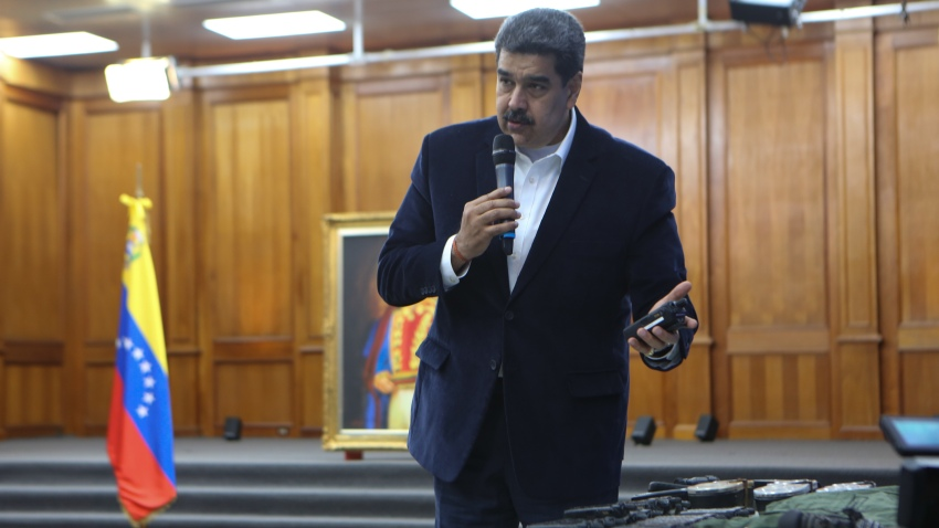 """Venezuelan President, Nicolas Maduro displays seized armament and passports after a meeting with members of the Armed Forces in Caracas, Venezuela on May 4, 2020. Venezuela's President Nicolas Maduro confirmed the detention of two US """"mercenaries"""" among 13 attackers involved in Sunday's two failed maritime raids."""