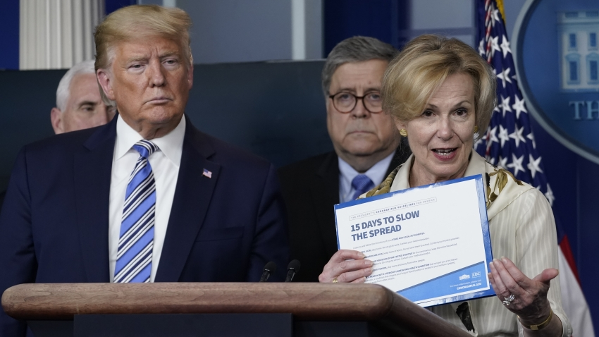 White House coronavirus response coordinator Deborah Birx holds up a CDC advisory asU.S. President Donald Trump and Attorney General listen at the daily coronavirus briefing at the White House on March 23, 2020 in Washington, DC. With the number of deaths caused by the coronavirus rising and foreseeable economic turmoil, the U.S. Congress continues to work on legislation for the nearly $2 trillion dollar aid package to deal with the COVID-19 pandemic.