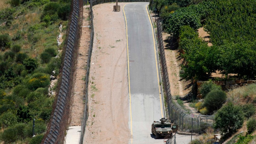 A picture taken on June 14, 2020 from the village of Majdal Shams in the Israeli-annexed Golan Heights shows an Israeli military vehicle patrolling the border fence with Syria.
