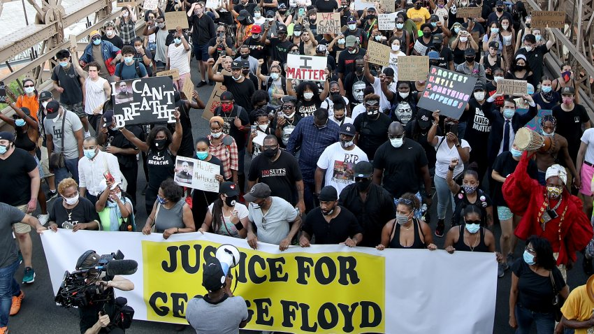 Terrence Floyd (Yankees Cap), brother of George Floyd walks with activists across the Brooklyn Bridge during a rally in response to the killing of his brother by Minneapolis police on June 04, 2020 in the Brooklyn borough of New York City.