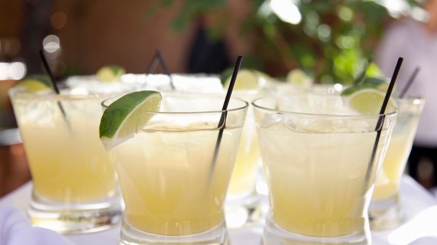 The margarita is a cocktail consisting of tequila mixed with orange-flavored liqueur and lime or lemon juice, often served with salt on the glass rim.
