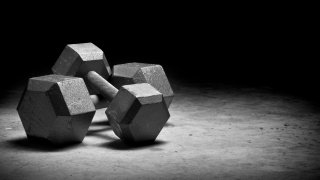 Dumbbells isolated on grungy surface