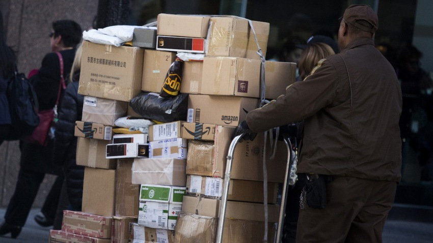 In this Nov. 30, 2015, file photo, a United Parcel Service Inc. (UPS) driver delivers packages on Cyber Monday in New York.