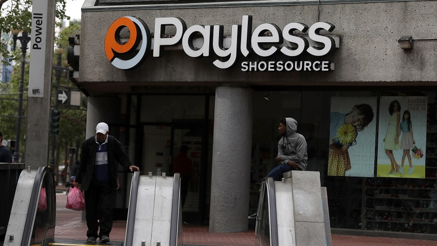 In this April 5, 2017, file photo, a pedestrian walks by a Payless Shoe Source store in San Francisco, California.