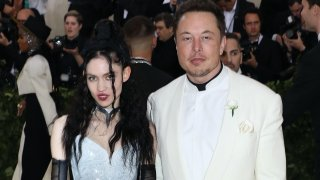 In this May 7, 2018, file photo, Grimes and Elon Musk attend the 2018 Costume Institute Benefit at the Metropolitan Museum of Art in New York City.