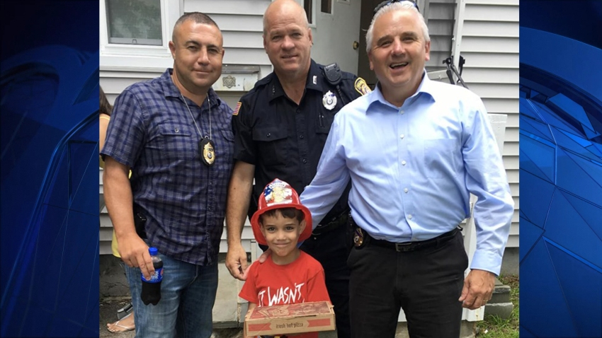Holbrook boy gets pizza and hat