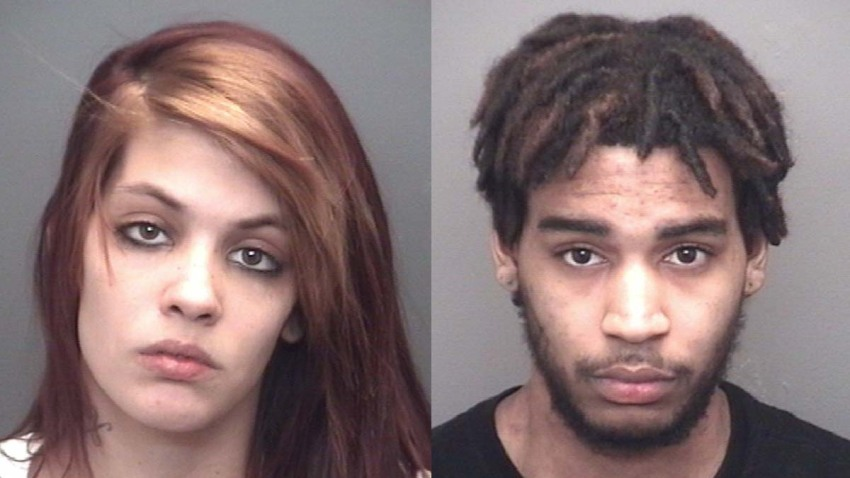 Couple charged after letting 1-year-old play with handgun