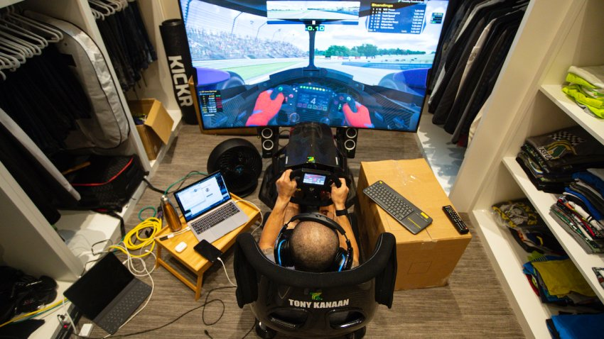 IndyCar driver Tony Kanaan, of Brazil, practices on his racing simulator in his home