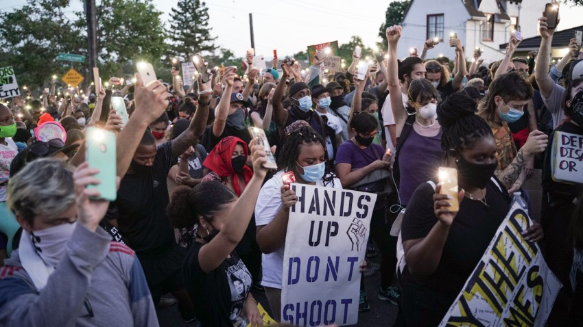 Demonstrators light candles during a youth led protest to defund the Oakland Police Department in front of Mayor Libby Schaaf's house in Oakland.