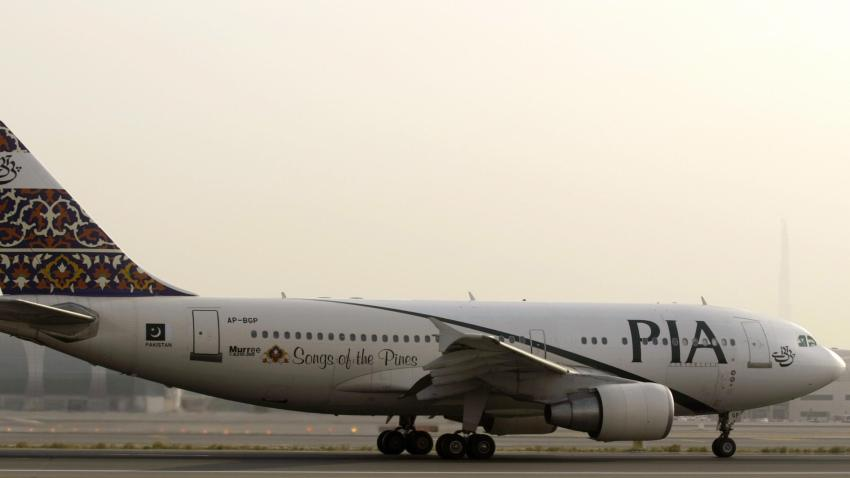 In this July 29, 2008, file photo, a Pakistan Airlines (PIA) Airbus A310-300 sits on the tarmac at Dubai airport.
