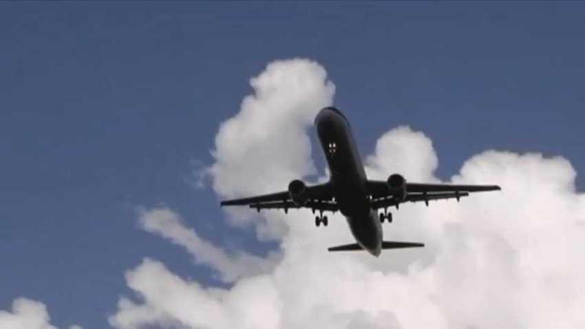 Plane over Logan Airport