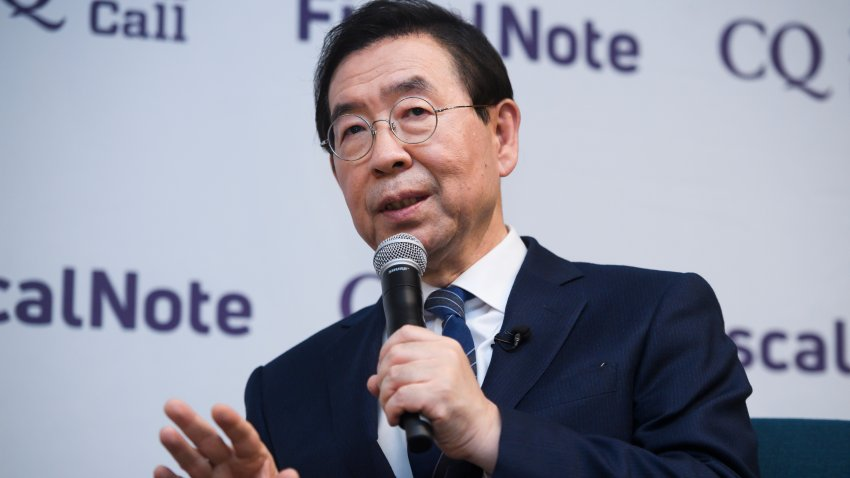 In this Jan. 13, 2020, file photo, Seoul Mayor Park Won-soon attends a question and answer session after a tour of FiscalNote and CQ-Roll Call, Inc via Getty Images offices in Washington.