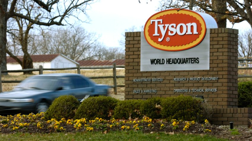 In this Jan. 29, 2006, file photo, a car passes in front of a Tyson Foods Inc., sign at Tyson headquarters in Springdale, Ark.