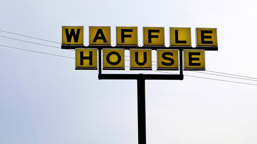 Waffle House restaurant sign, Auburn, Ala., July 6, 2018.