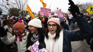 In this Jan. 18, 2020, file photo, Georgetown students, from left, Emma Garman, Annmarie Rotatori and Claire Tebbutt, join the Women's March near the White House in Washington.