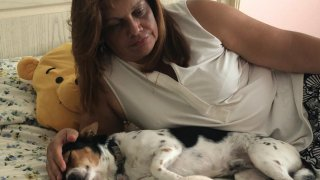 María Burgos finds comfort in her dogs. She says being with them helps her canalize all the stress.