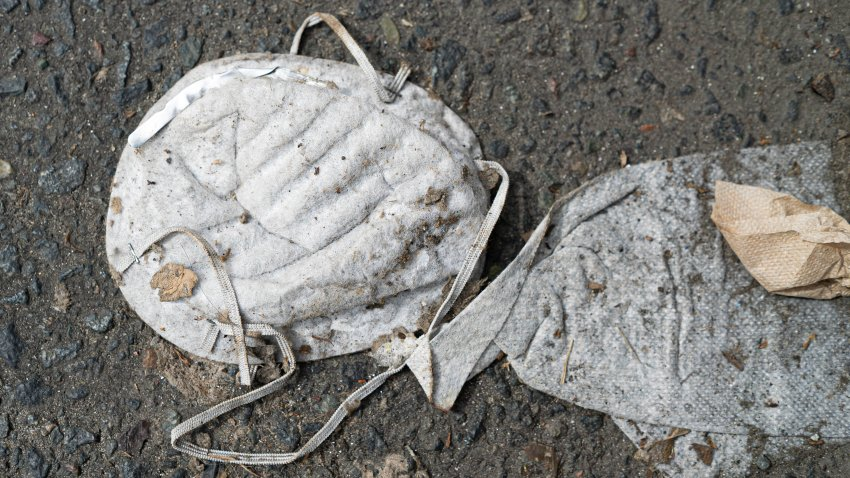 A smashed surgical mask on the street