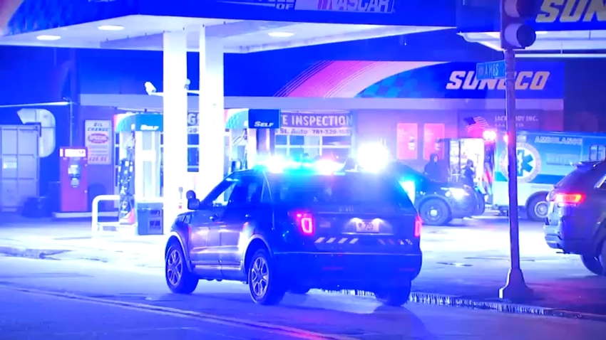 Dedham police are searching for two suspects after a clerk was shot during a robbery late Thursday night.