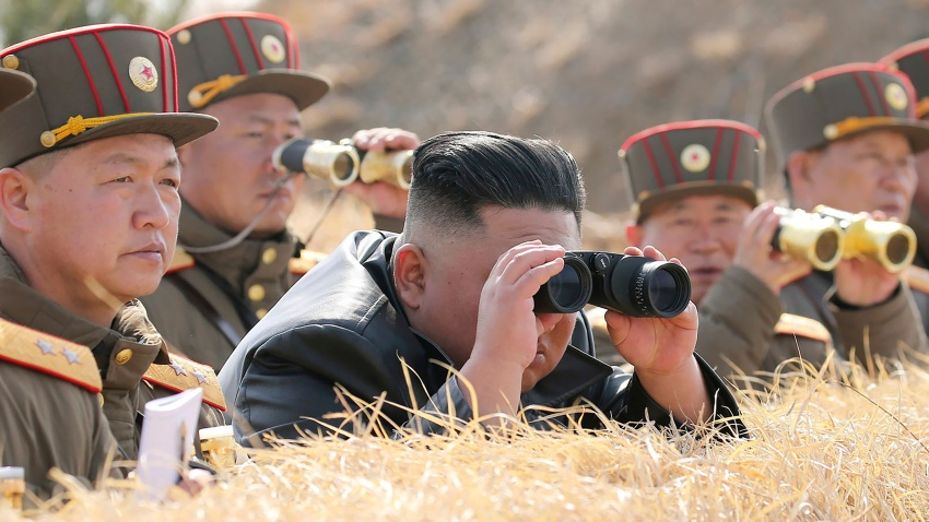 North Korean leader Kim Jong Un supervises an artillery throwing competition